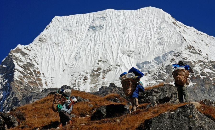 Sherpa Porters in Rolwaling Valley beneath Mount Chobutse