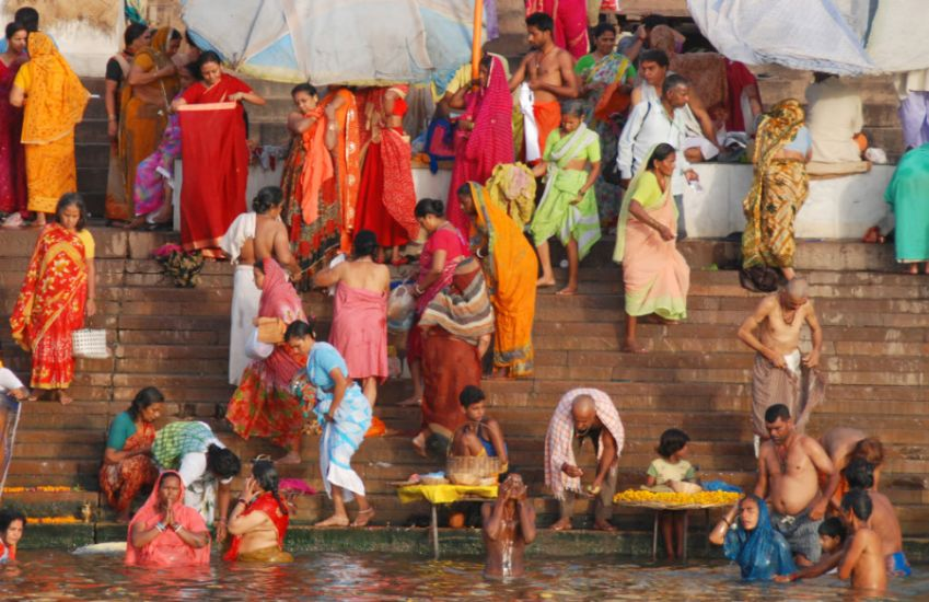 Bathing in the Ganga ( Ganges ) River at Varanasi in India