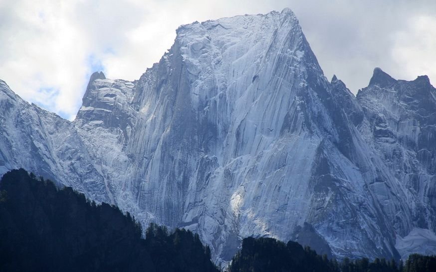 The north-east face of Piz Badile ( 3308m, 10,853ft ) in SE Switzerland