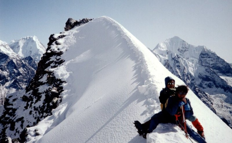 Climbers on the summit arete of Yala Peak in the Langtang Valley